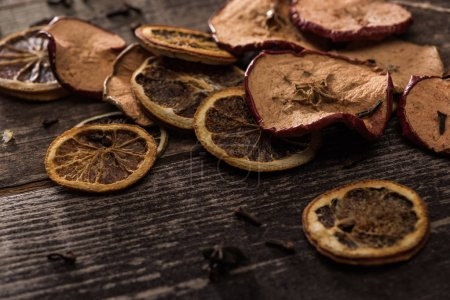 dried citrus and apple slices on wooden surface