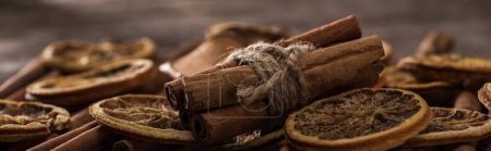 Photo for Close up view of dried orange slices and cinnamon bunch, panoramic shot - Royalty Free Image