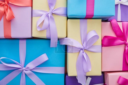 Photo for Top view of multicolored gift boxes with ribbons and bows - Royalty Free Image