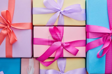 Photo for Flat lay with multicolored gift boxes with ribbons and bows - Royalty Free Image