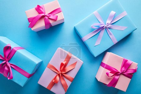 Photo for Top view of colorful gift boxes on blue background - Royalty Free Image