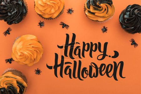 Photo for Top view of delicious Halloween cupcakes with spiders on orange background with happy Halloween illustration - Royalty Free Image