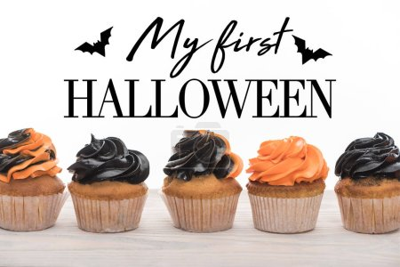 Photo for Delicious Halloween orange and black cupcakes isolated on white with me first Halloween illustration - Royalty Free Image