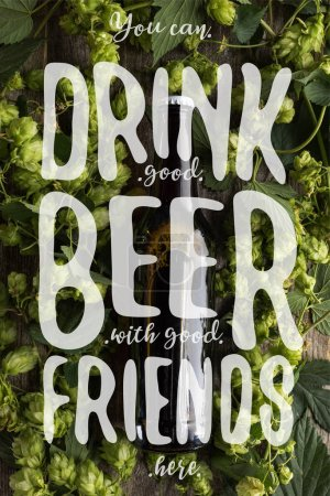 top view of fresh beer in bottle with green hop on wooden surface with you can drink good beer with good friends here illustration