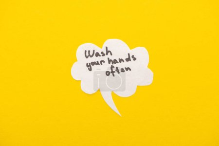 top view of speech bubbles with wash your hands lettering on yellow background