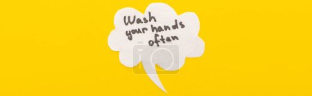 Photo for Top view of speech bubbles with wash your hands lettering on yellow background, panoramic shot - Royalty Free Image