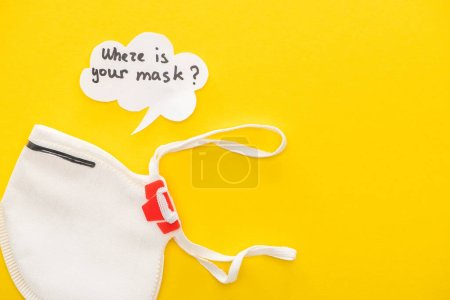 top view of safety mask with speech bubble on yellow background