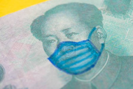close up view of banknote with drawn medical mask