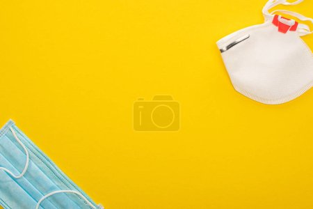 Photo for Top view of medical and safety masks on yellow background - Royalty Free Image