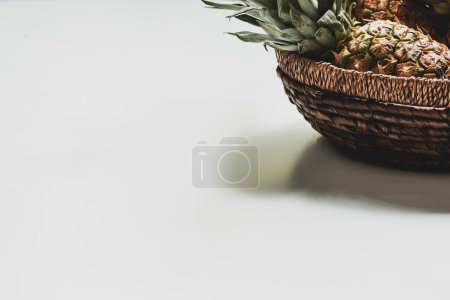 Photo for Fresh delicious pineapple in basket on white background - Royalty Free Image