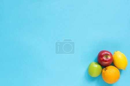 Photo for Top view of ripe fruits on blue background - Royalty Free Image