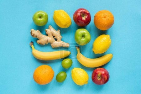 Photo for Top view of ripe whole fruits on blue background - Royalty Free Image