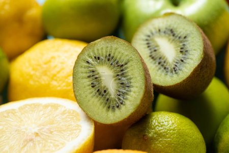 Photo for Close up view of kiwi halves on lemons and limes - Royalty Free Image