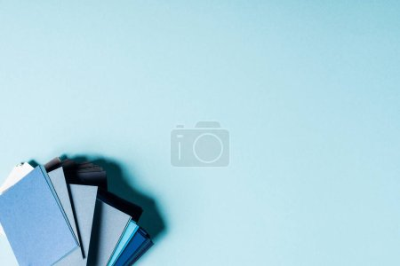 Photo for Top view of color swatches on blue background with copy space - Royalty Free Image