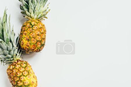 Photo for Top view of fresh ripe pineapples on white background - Royalty Free Image