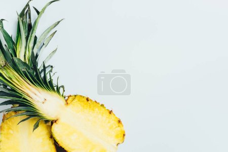 Photo for Top view of juicy pineapple halves on white background - Royalty Free Image