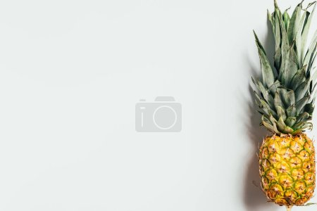 Photo for Top view of ripe pineapple with green leaves on white background - Royalty Free Image