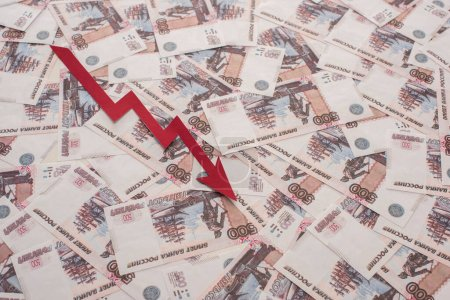 KYIV, UKRAINE - MARCH 25, 2020: top view of crisis graph near ruble banknotes