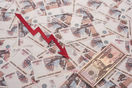 KYIV, UKRAINE - MARCH 25, 2020: top view of crisis graph near russian rubles and dollar banknote