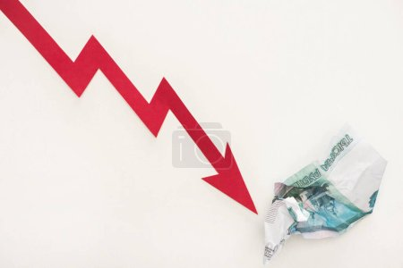 top view of crisis graph near russian ruble banknote isolated on white