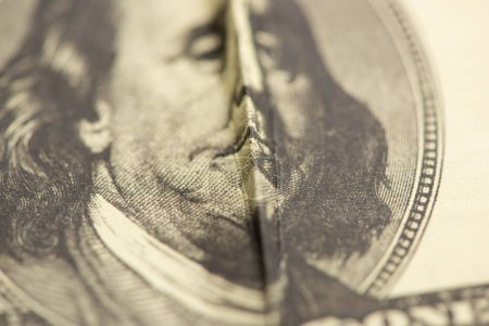 selective focus of crumpled dollar banknote