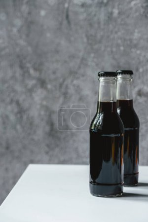 Photo for Cold brew coffee in bottles on white table - Royalty Free Image