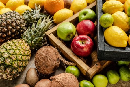 Photo for Ripe fresh summer fruits in wooden boxes - Royalty Free Image