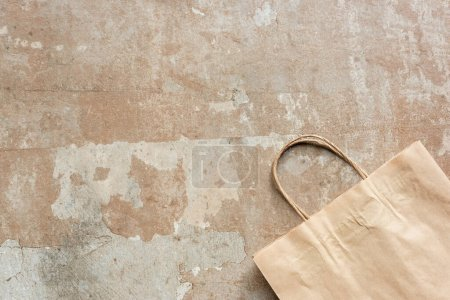 Photo for Top view of beige paper bag on weathered surface - Royalty Free Image