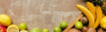 Photo for Top view of ripe summer fruits in wooden box and on weathered beige surface, panoramic crop - Royalty Free Image