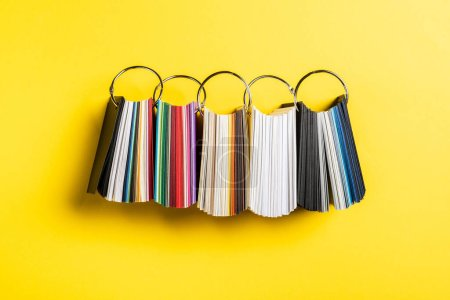 Photo for Top view of colorful samples set on yellow - Royalty Free Image