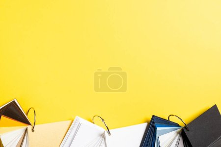 Photo for Top view of set with blank colorful samples on yellow - Royalty Free Image