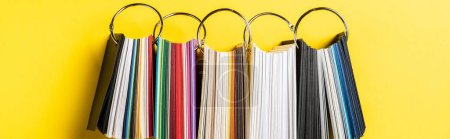 Photo for Panoramic shot of colorful samples set on yellow - Royalty Free Image