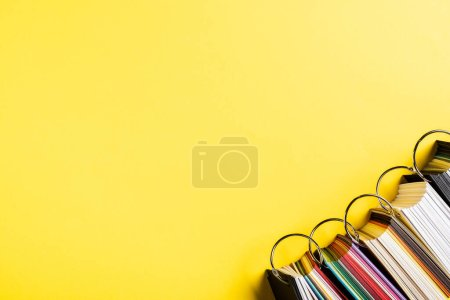 Photo for Top view of colorful palettes on yellow - Royalty Free Image