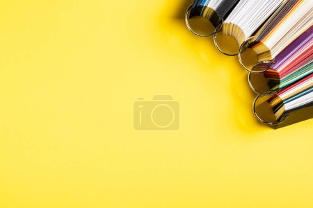 Photo for Top view of set with colorful palettes on yellow - Royalty Free Image
