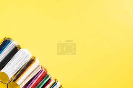 Photo for Top view of catalogs with colorful palettes on yellow - Royalty Free Image