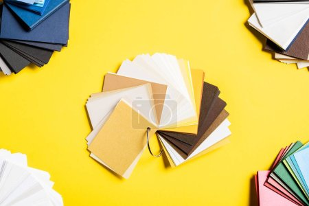 Photo for Top view of variation of colorful palettes on yellow - Royalty Free Image