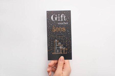 Photo pour Vue du dessus de la femme tenant un chèque-cadeau noir avec signe dollars sur fond blanc - image libre de droit
