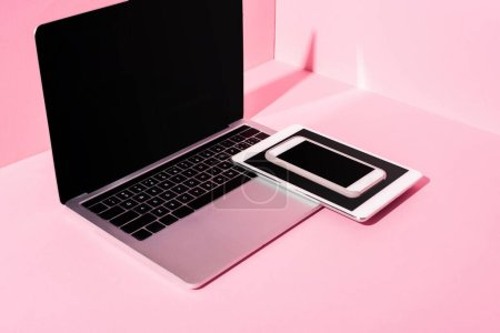 Photo for Modern gadgets with blank screens on pink background - Royalty Free Image