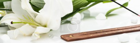 Photo for Aroma stick on wooden stand near lily on white background, panoramic shot - Royalty Free Image