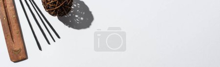 Photo for Top view of aroma sticks, wooden stand and decorative ball on white background, panoramic shot - Royalty Free Image