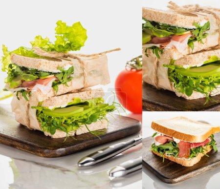 Collage aus frischen grünen leckeren Sandwiches mit Fleisch auf Holzschneidebrett auf marmorweißer Oberfläche