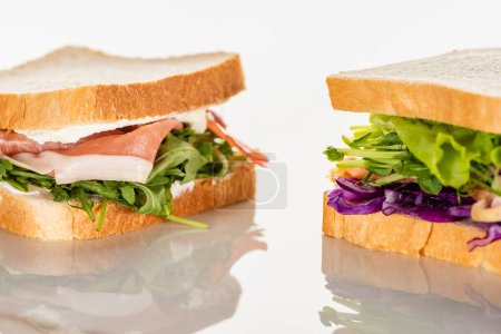 Photo for Fresh green sandwiches with prosciutto on white surface - Royalty Free Image