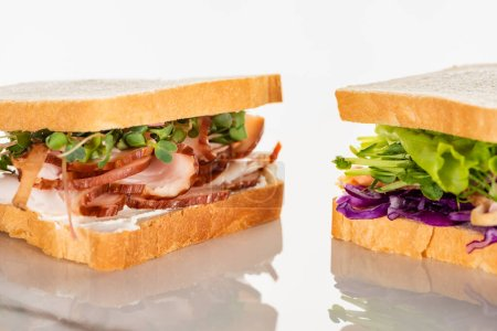 fresh green sandwiches with meat on white surface