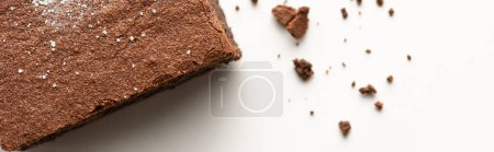 Photo for Top view of delicious brownie piece on white background, panoramic shot - Royalty Free Image
