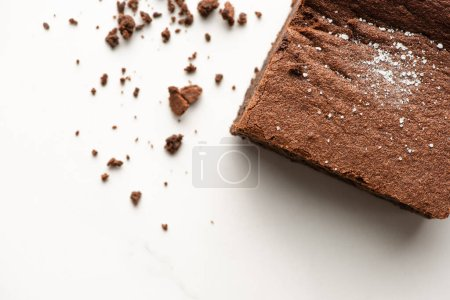 Photo for Top view of delicious brownie piece on white background - Royalty Free Image