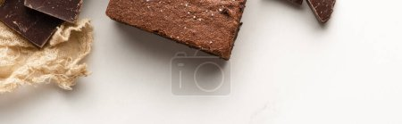Photo for Top view of delicious brownie piece with chocolate on white background, panoramic shot - Royalty Free Image