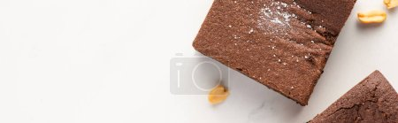 Photo for Top view of delicious brownie pieces with nuts on white background, panoramic shot - Royalty Free Image