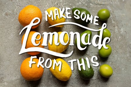 Photo for Flat lay with colorful oranges, avocado, limes and lemons on grey concrete surface, make some lemonade from this illustration - Royalty Free Image