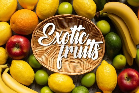 Photo for Top view of tasty colorful fruits around wicker basket with exotic fruits illustration - Royalty Free Image