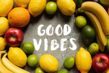 Photo for Top view of tasty colorful fruits on grey concrete surface, good vibes illustration - Royalty Free Image